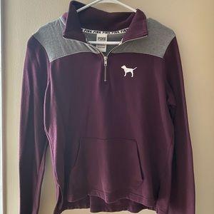 maroon half zip with logo on back!